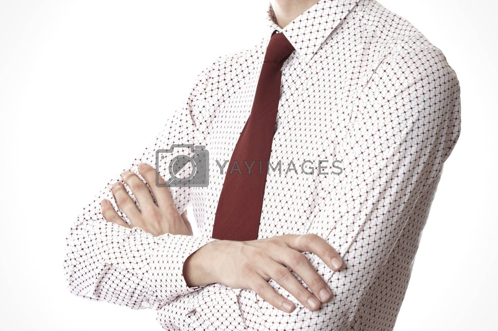 Torso of businessman with arms crossed on a white background