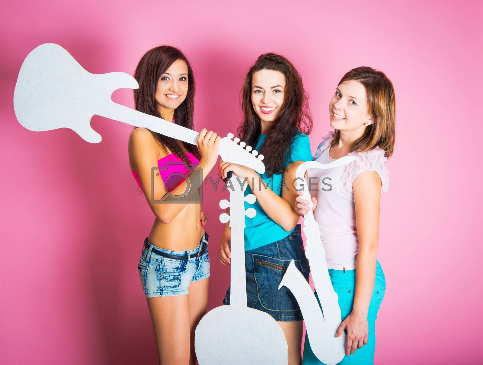 three beautiful teenage girls with musical instruments