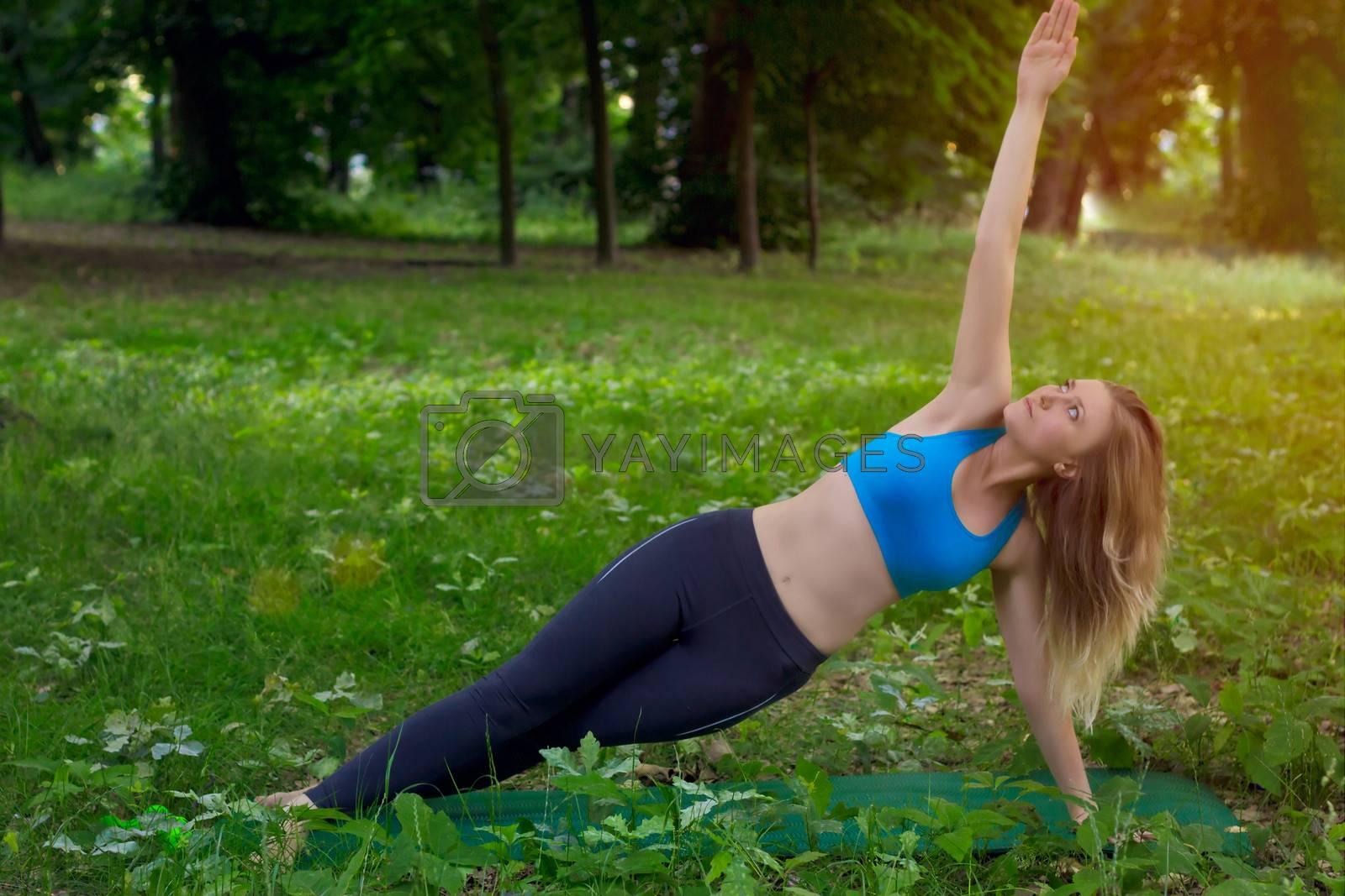 girl doing yoga in the park