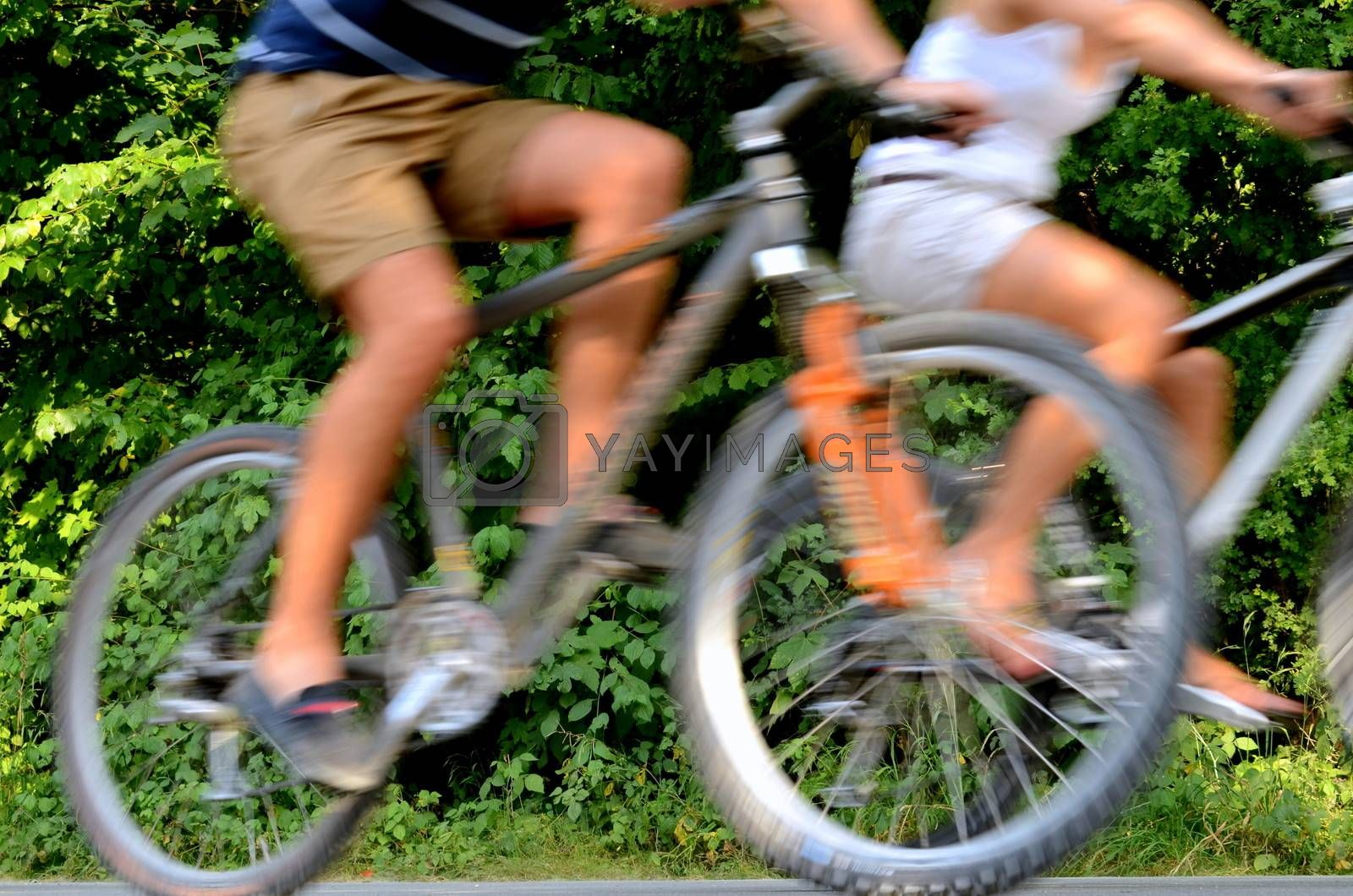 Healthy Lifestyle Image Of A Couple Cycling WIth Blurred Motion