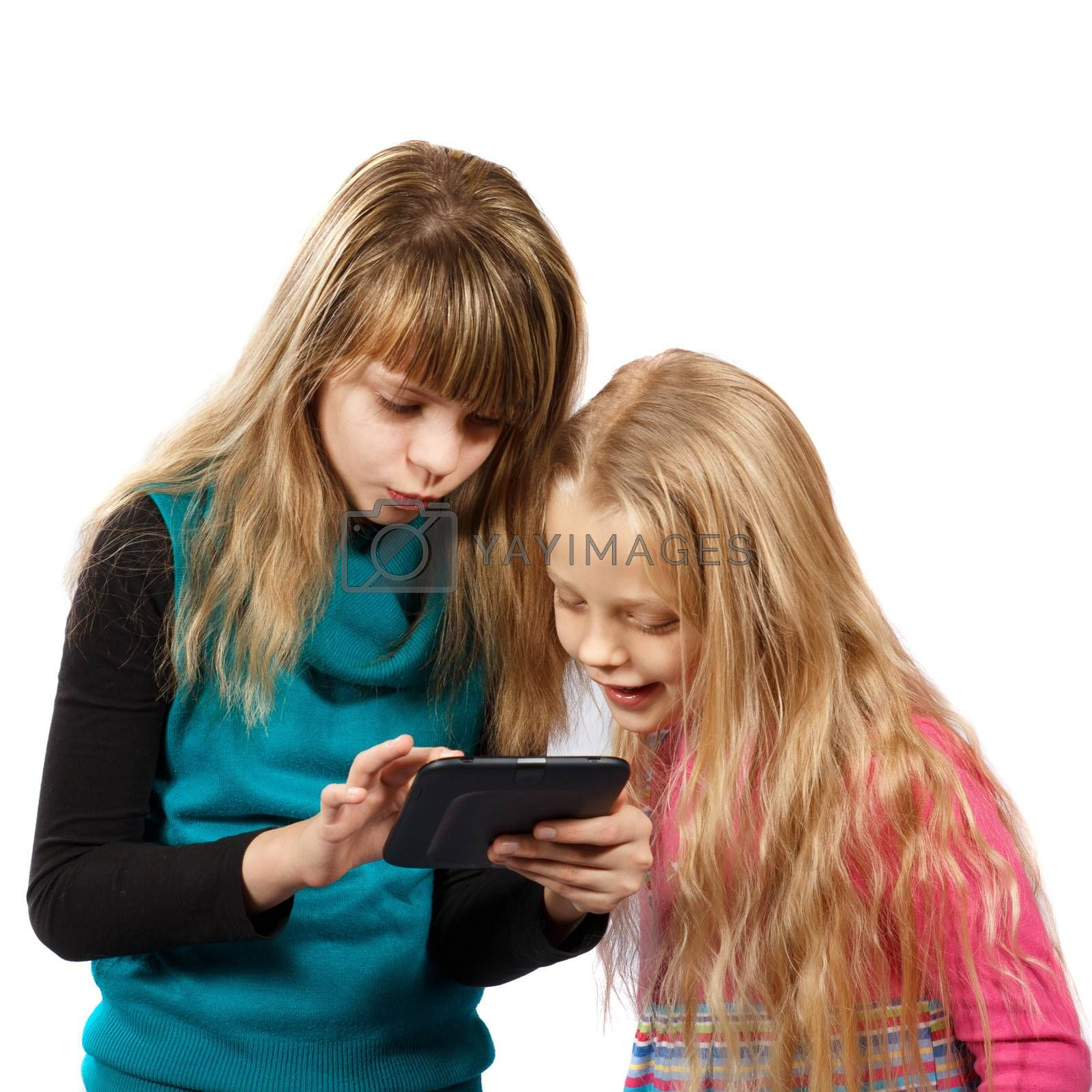 two girls looking at something in tablet PC on a white background