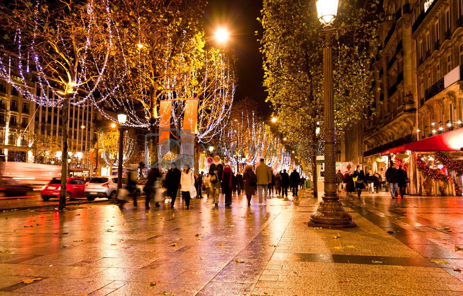 the famous shooping district Champs Elysees illuminated with Christmas light in Paris