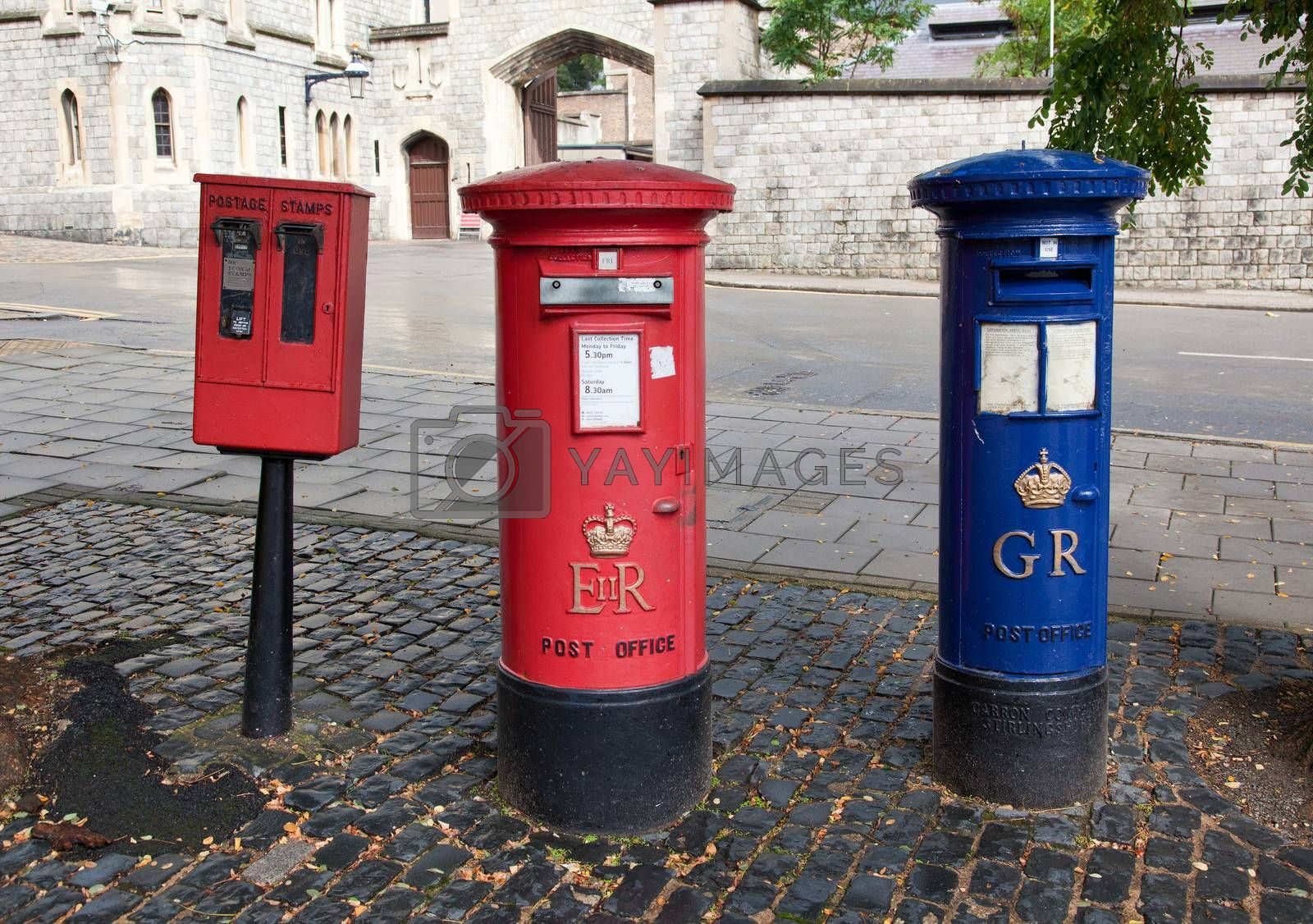 red British mail box on a city street