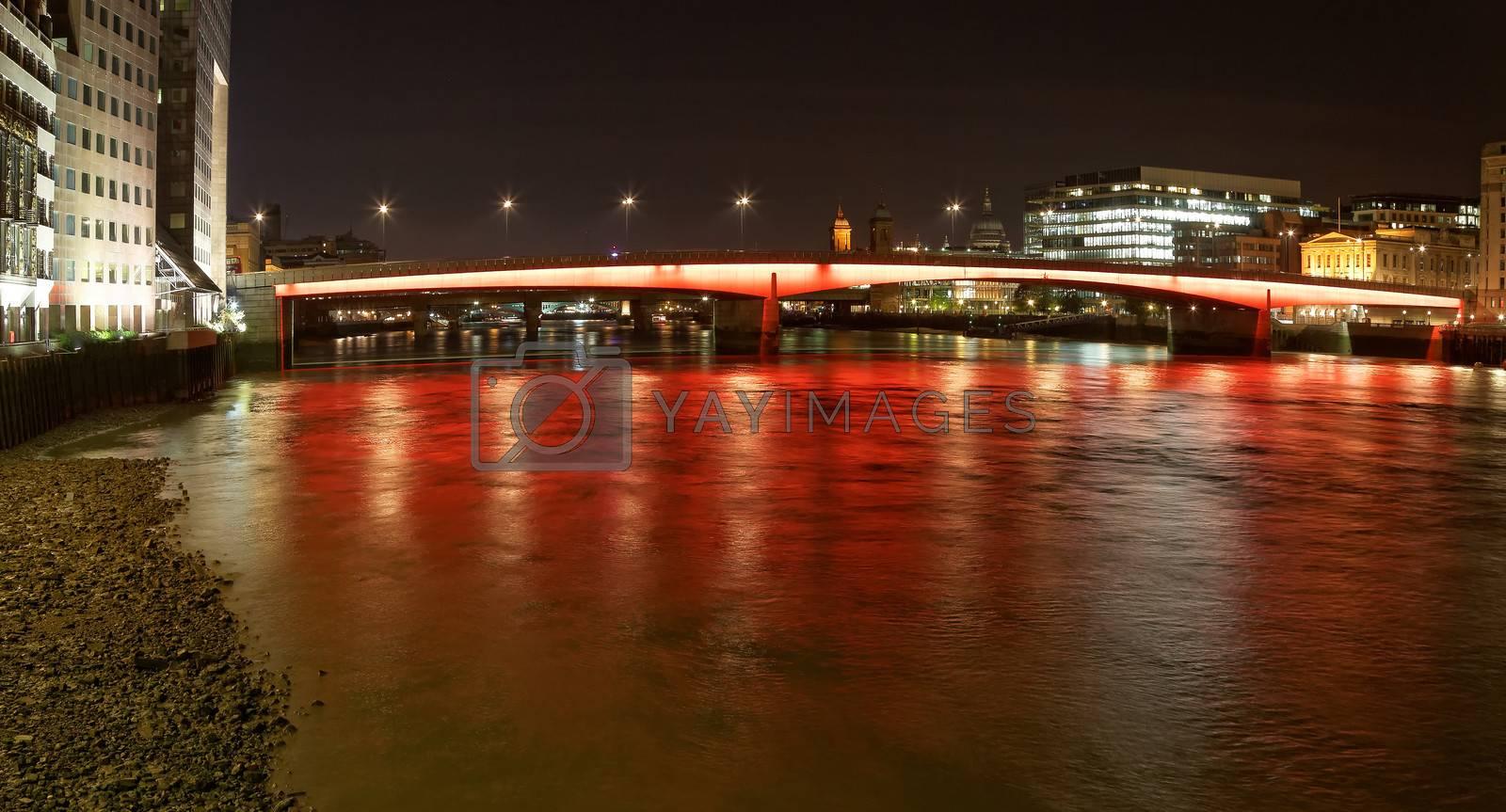 London Bridge with red and orange lights