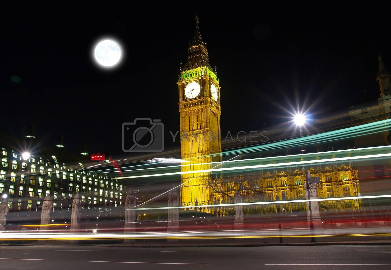 Big Ben at night with bus light tracks
