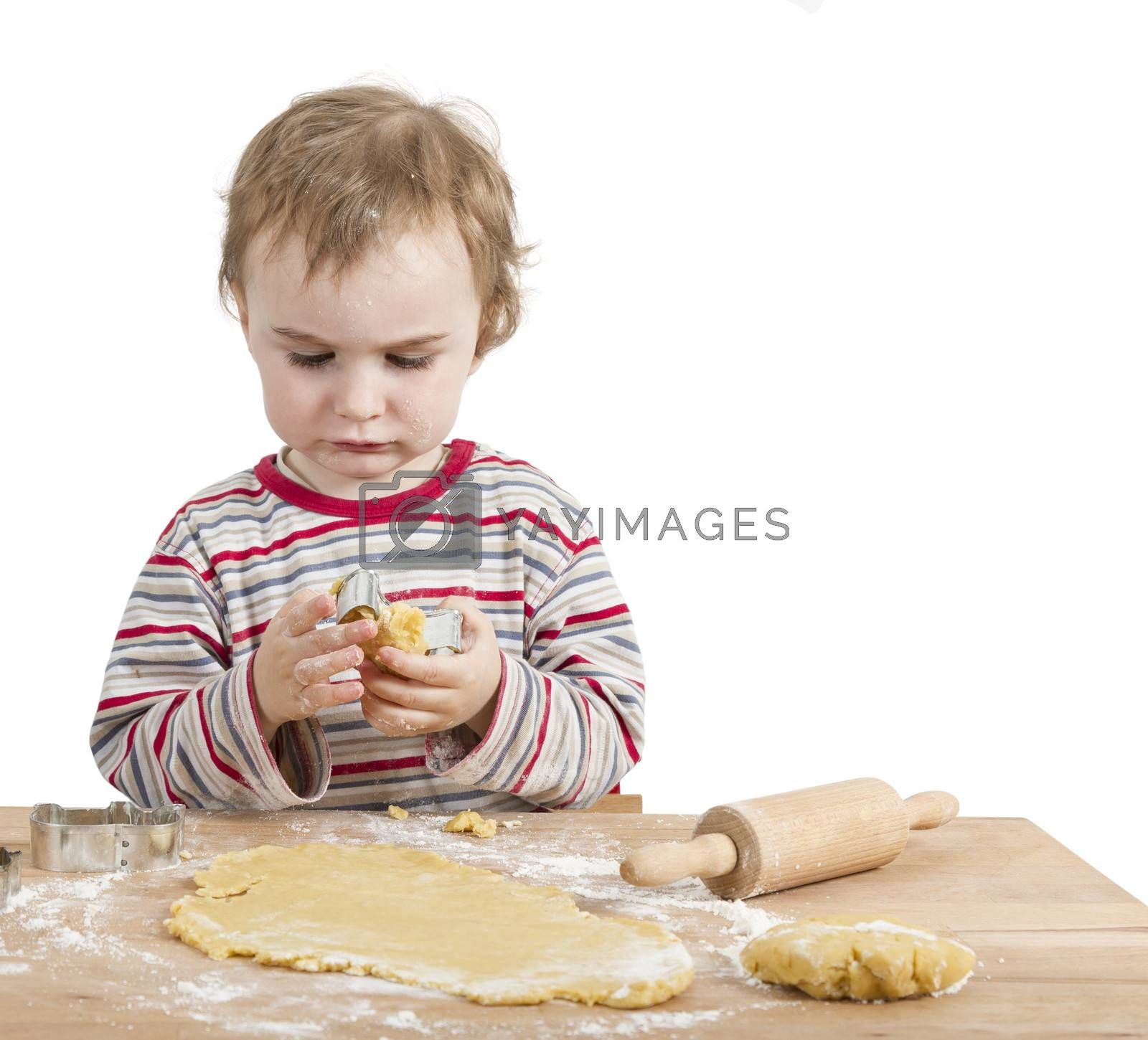 young child with rolling pin and dough. Isolated on white background