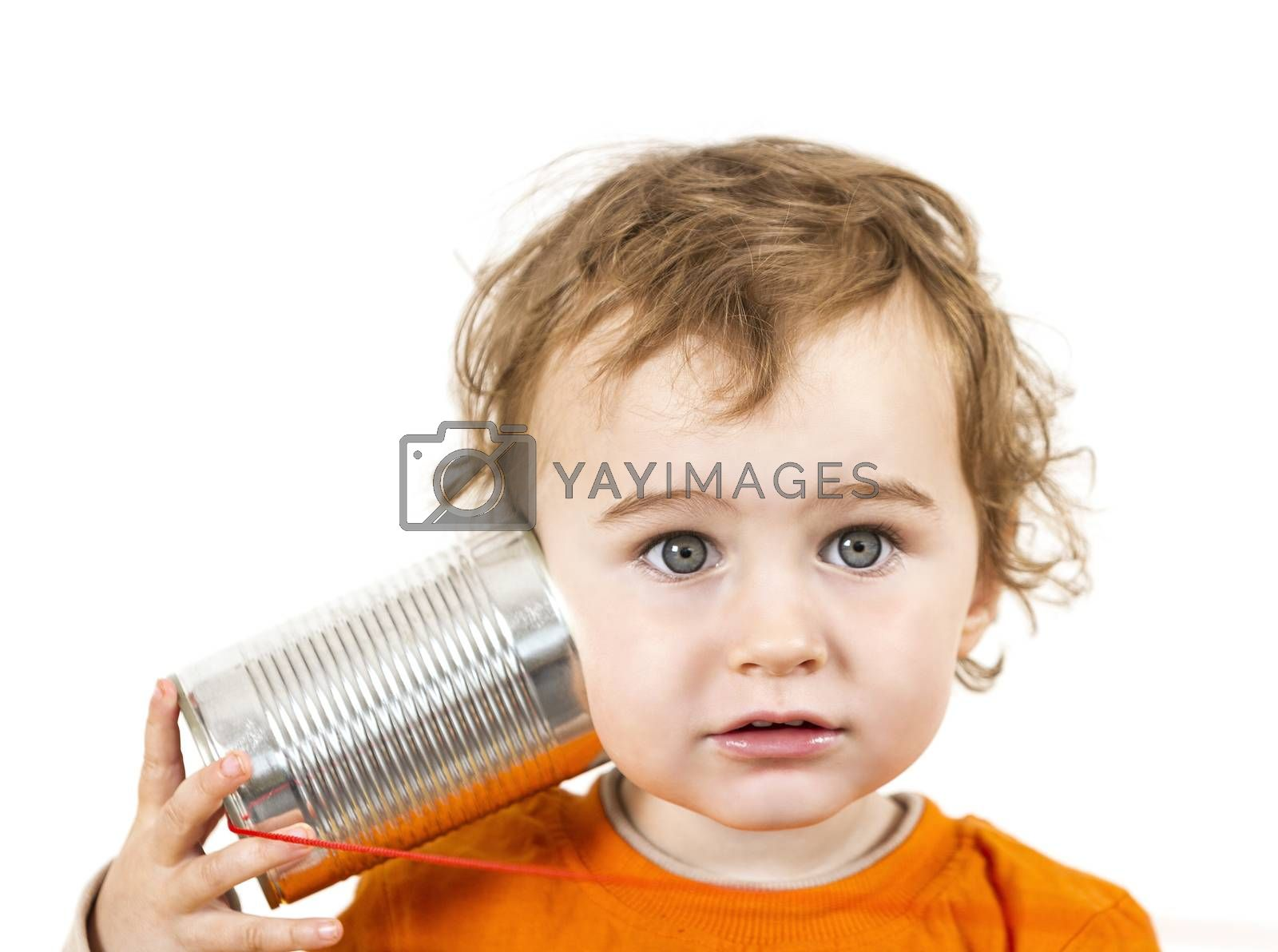 young caucasian child with tin can phone looking to camera