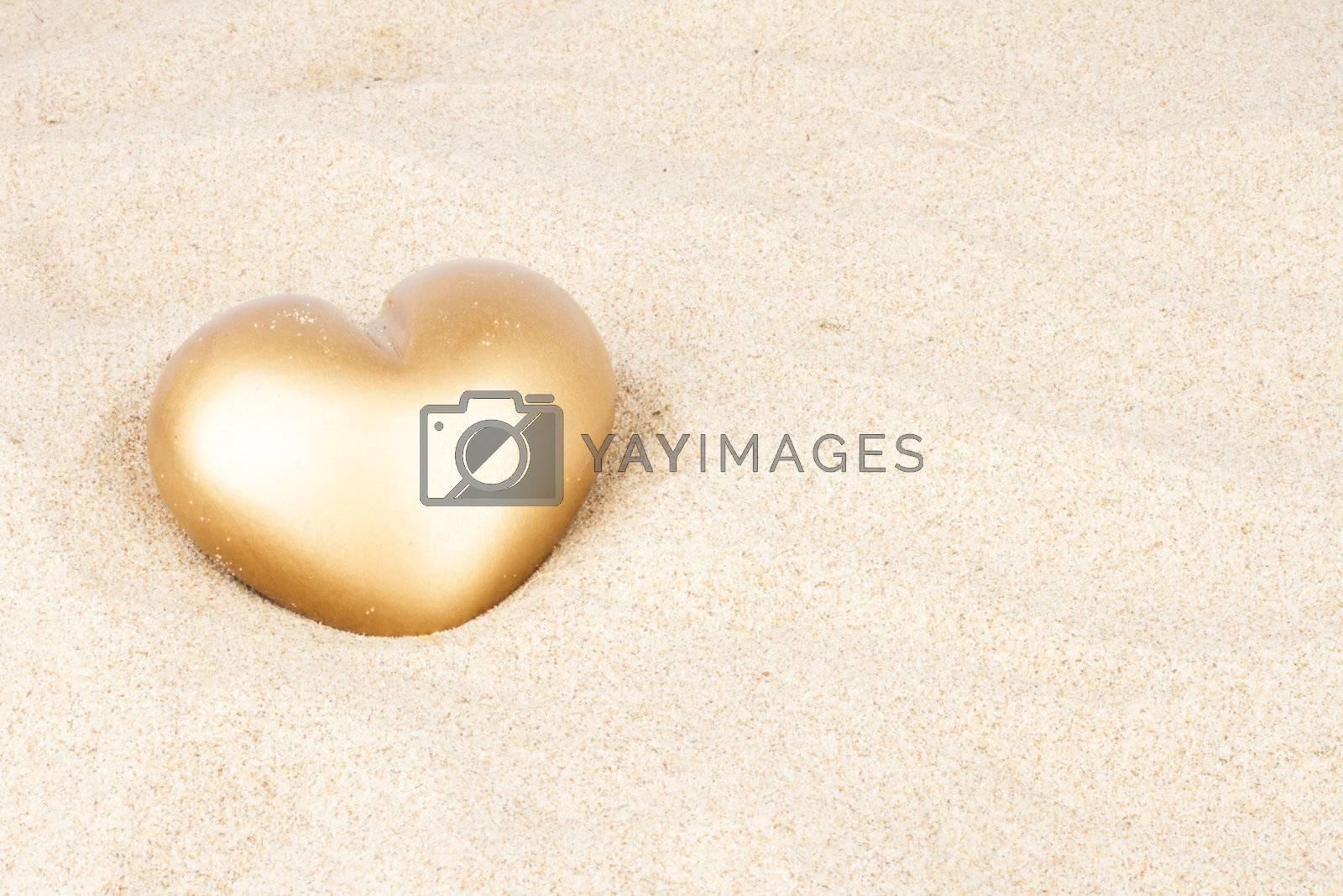 Golden heart in the sand