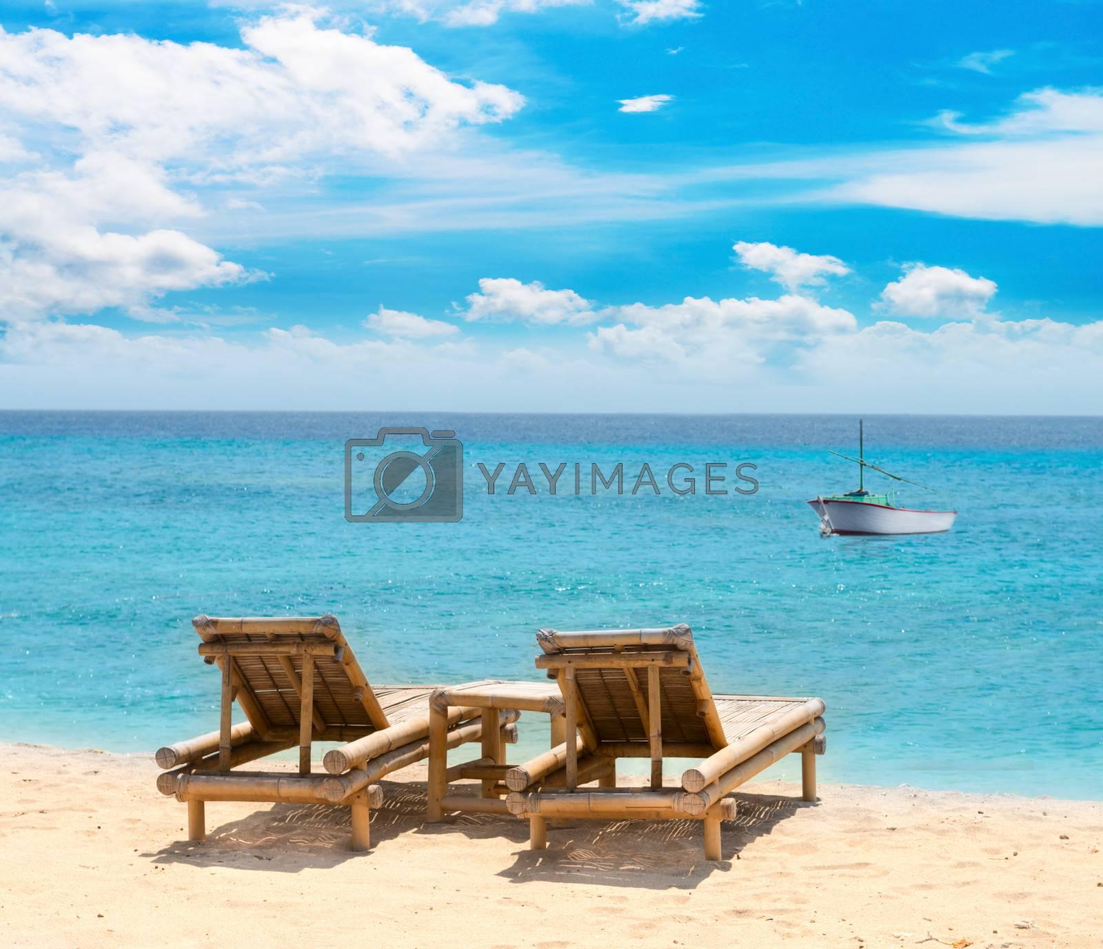 Tropical seascape with bamboo beach beds by Iryna Rasko
