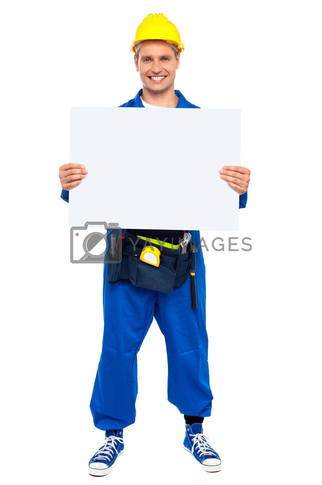 Industrial contractor showing blank billboard, full length shot