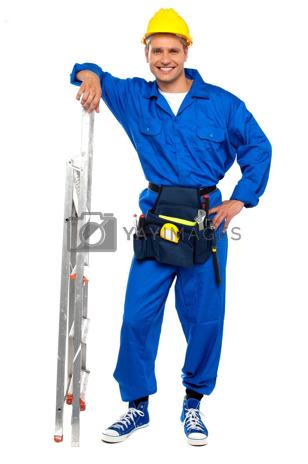 Full length portrait of smiling Industrial contractor resting hand on stepladder