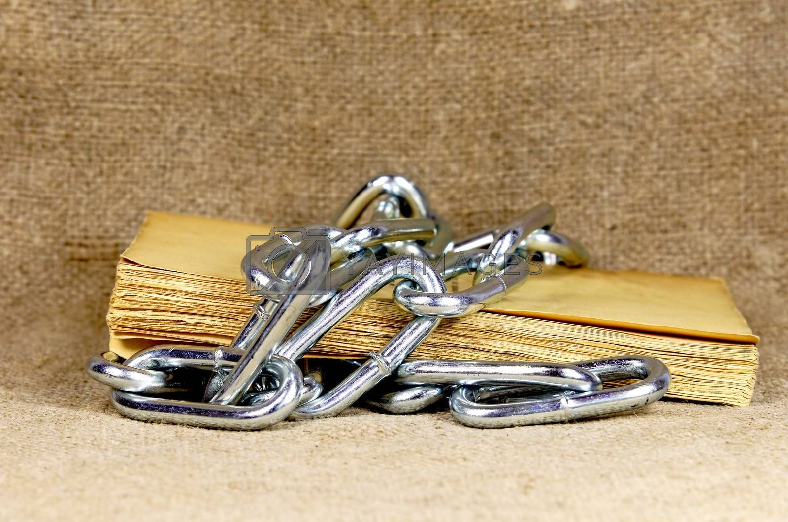 old book surrounded with chain