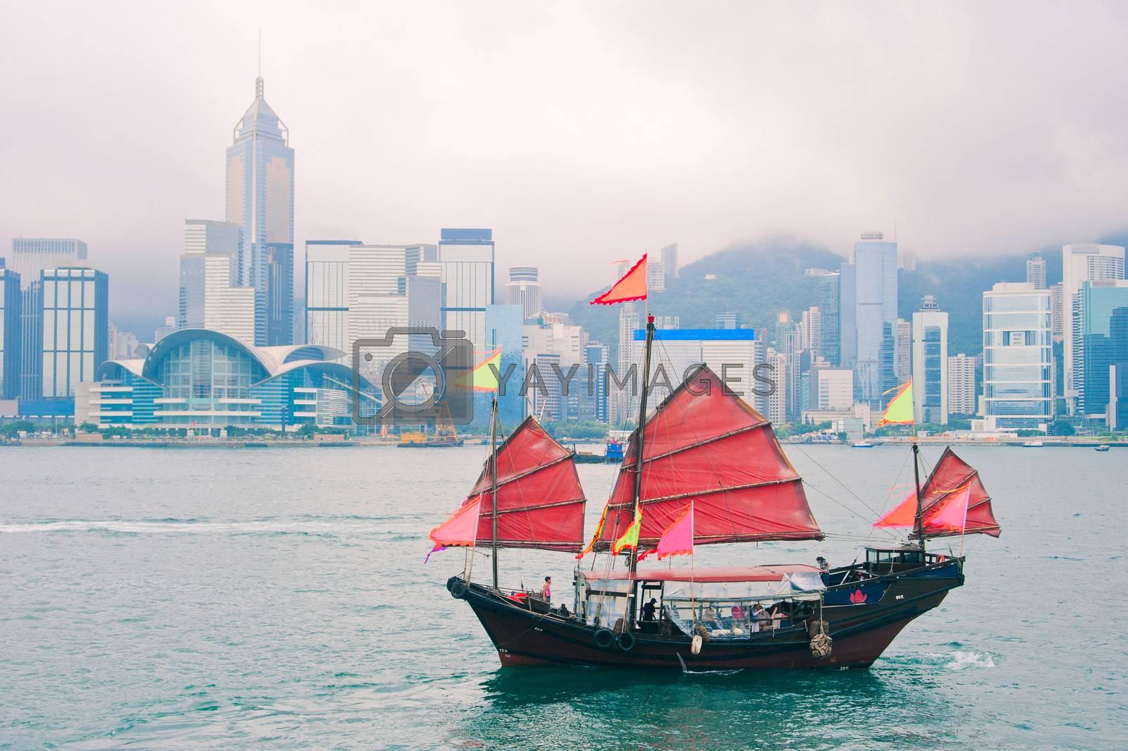 Traditional chinese-style sailboat sailing in Hong Kong harbor