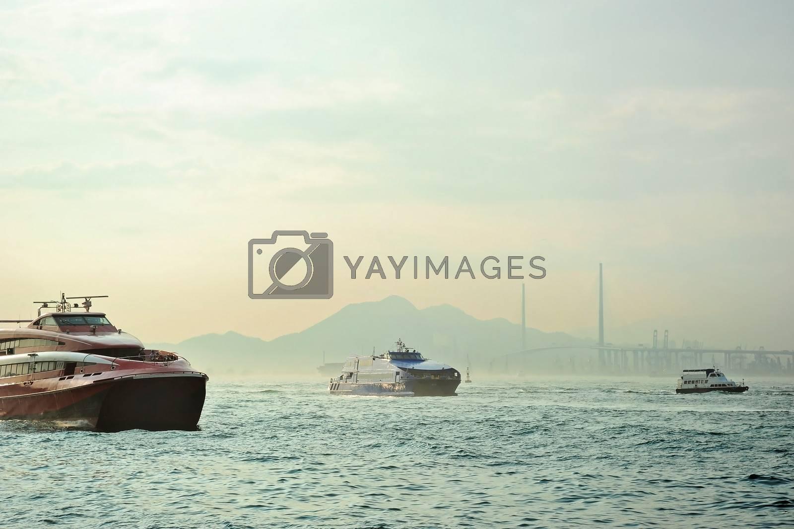 Macao to Hong Kong ferry boats in Hong Kong harbor. Tsing-Ma Bridge on the background