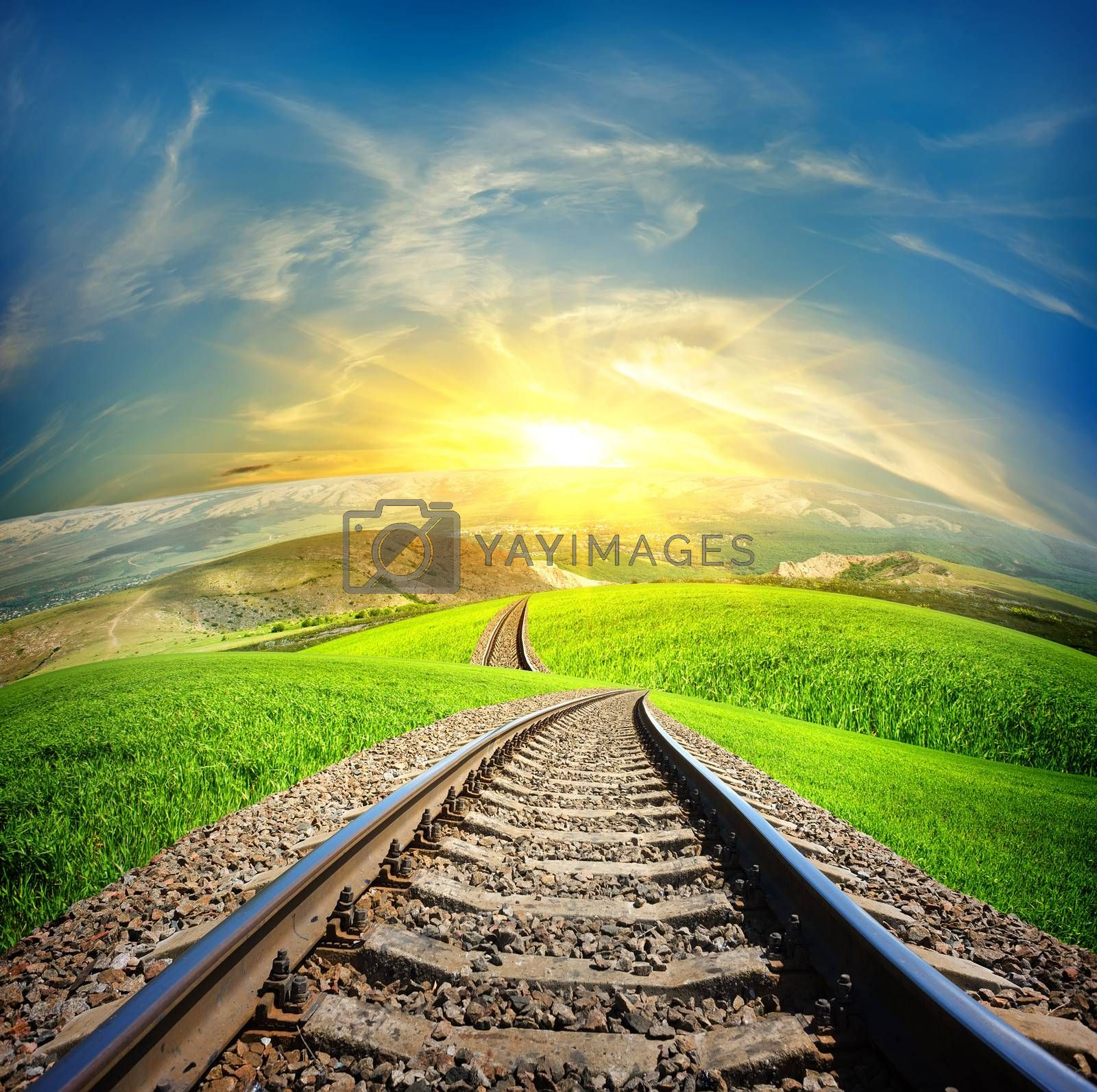 Railway in mountain fields in the sunlight