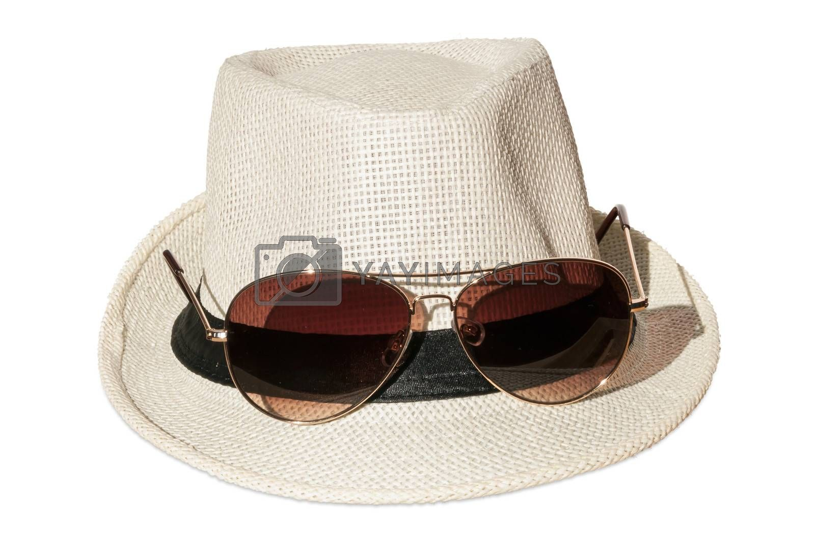 White hat with sunglasses isolated over white background.