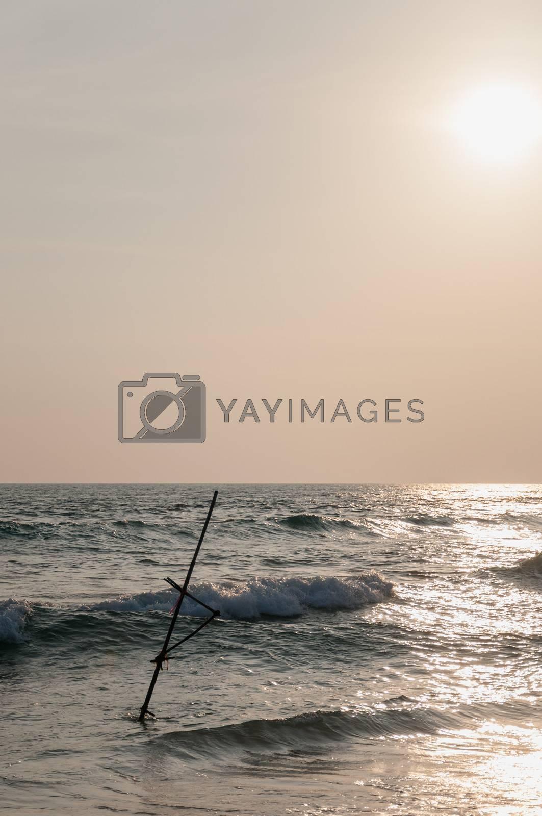 The stick of Sri Lankan fisherman in ocean.