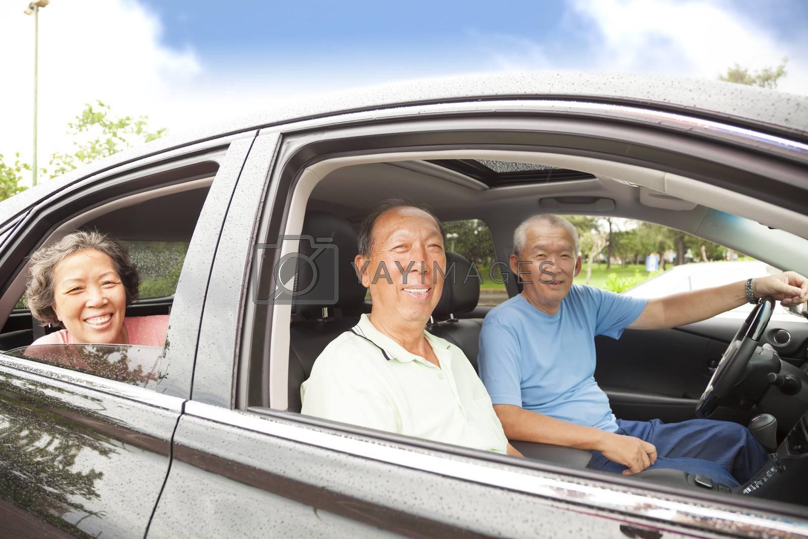 happy seniors enjoying road trip and travel