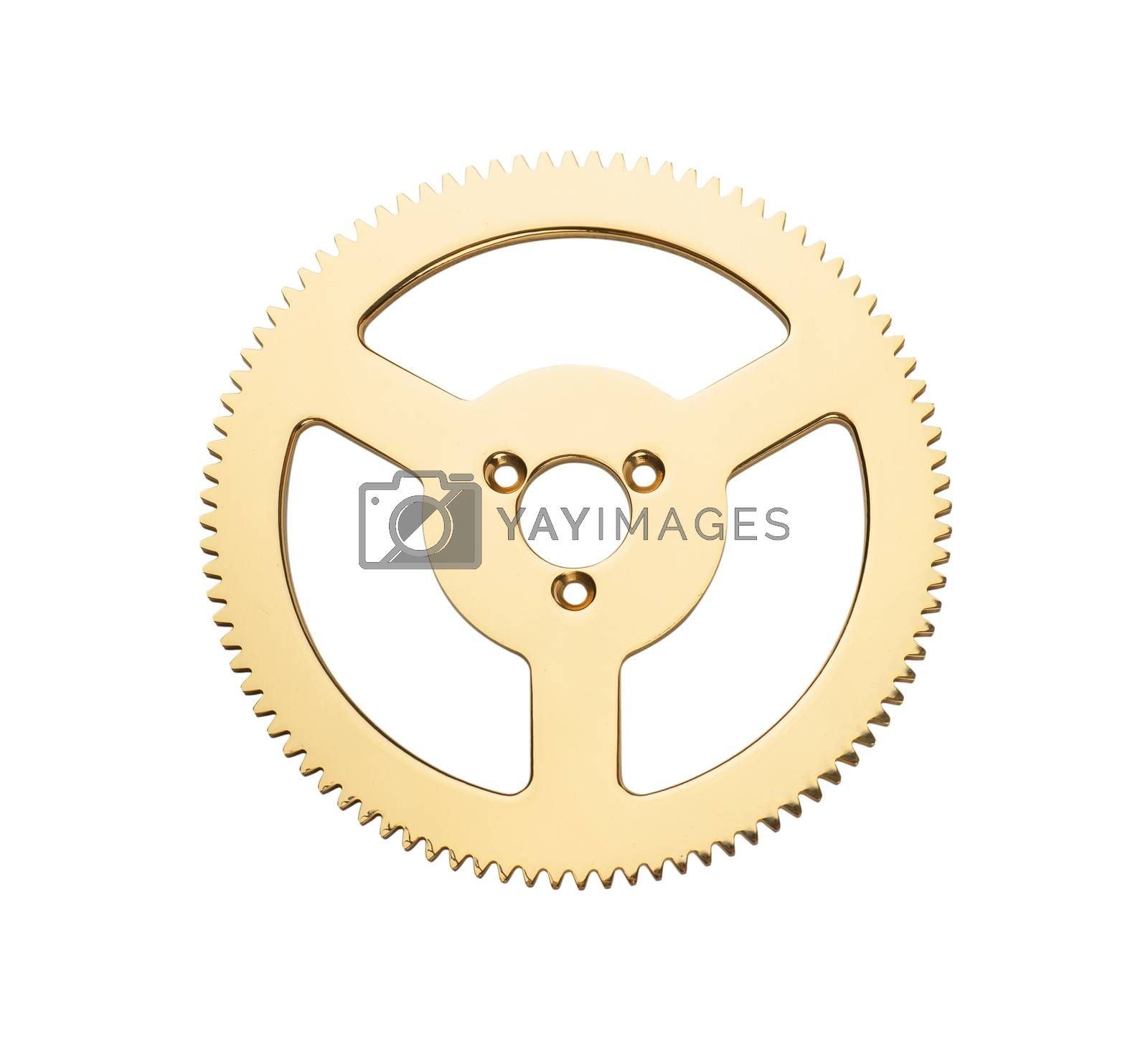 Macro view of single golden gear isolated over white background