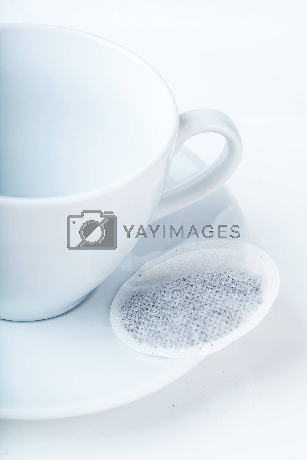 Closeup view of empty cup and teabag on a plate
