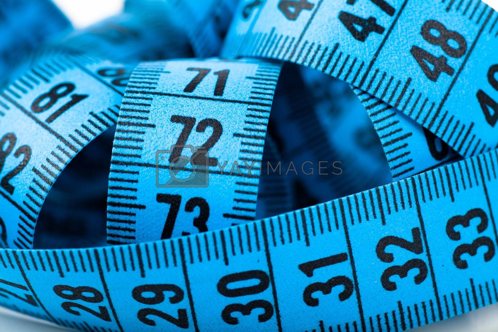 Closeup view of tangled blue measuring tape
