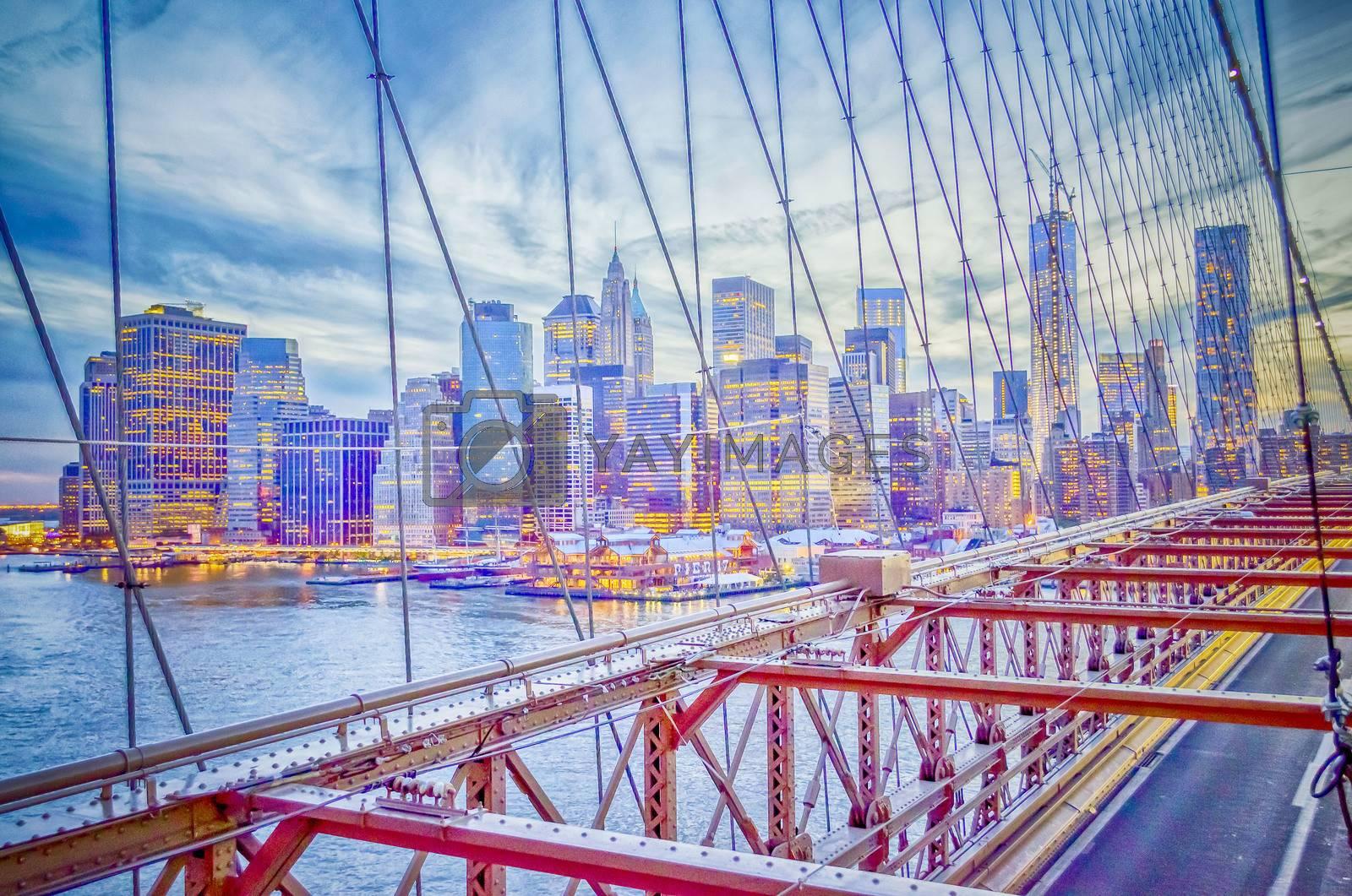 Manhattan View through the wires of Brooklyn Bridge