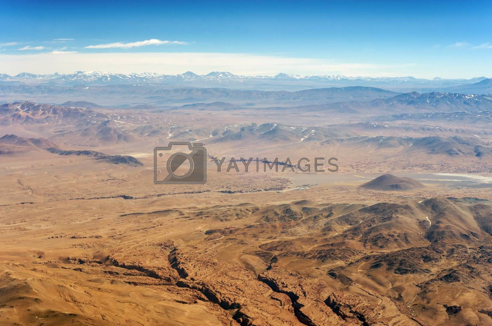 Aerial view of dry desert and the Andes Mountains somewhere over South America
