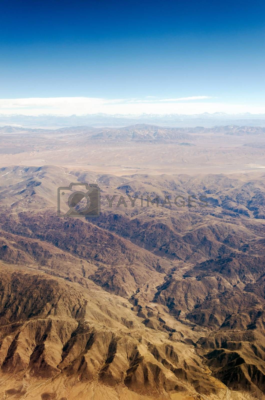 View of a dry desert from an airplane somewhere over South America
