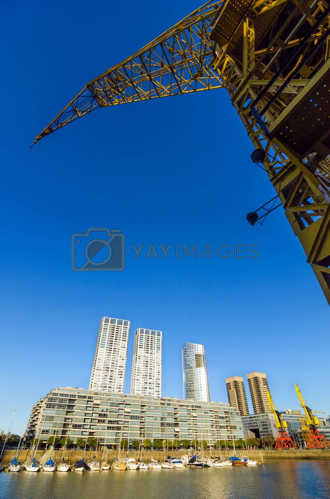 Waterfront of Puerto Madero in Buenos Aires, Argentina with a tall yellow crane rising above