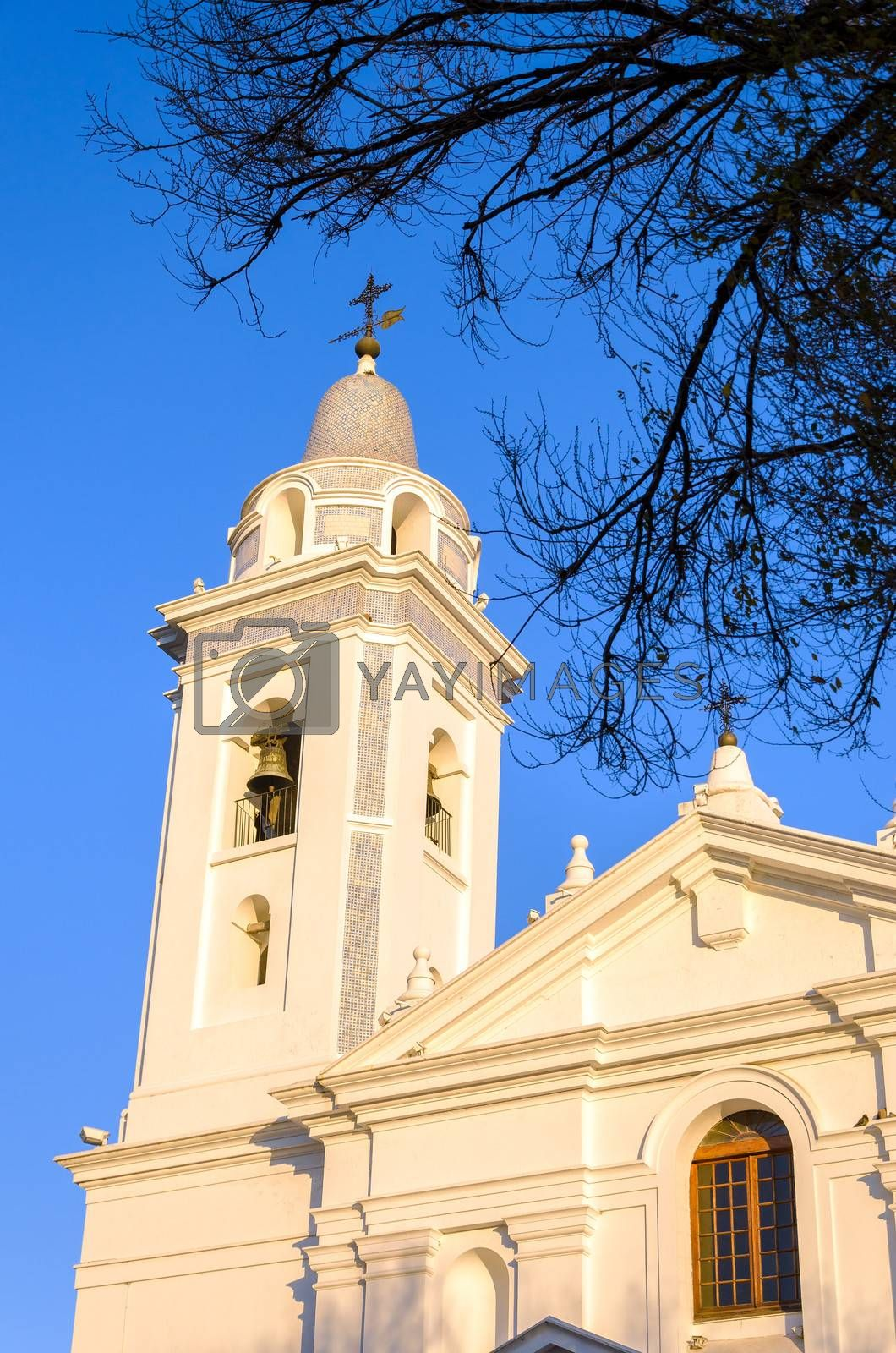 Tower of a white church near Recoleta Cemetery in Buenos Aires, Argentina