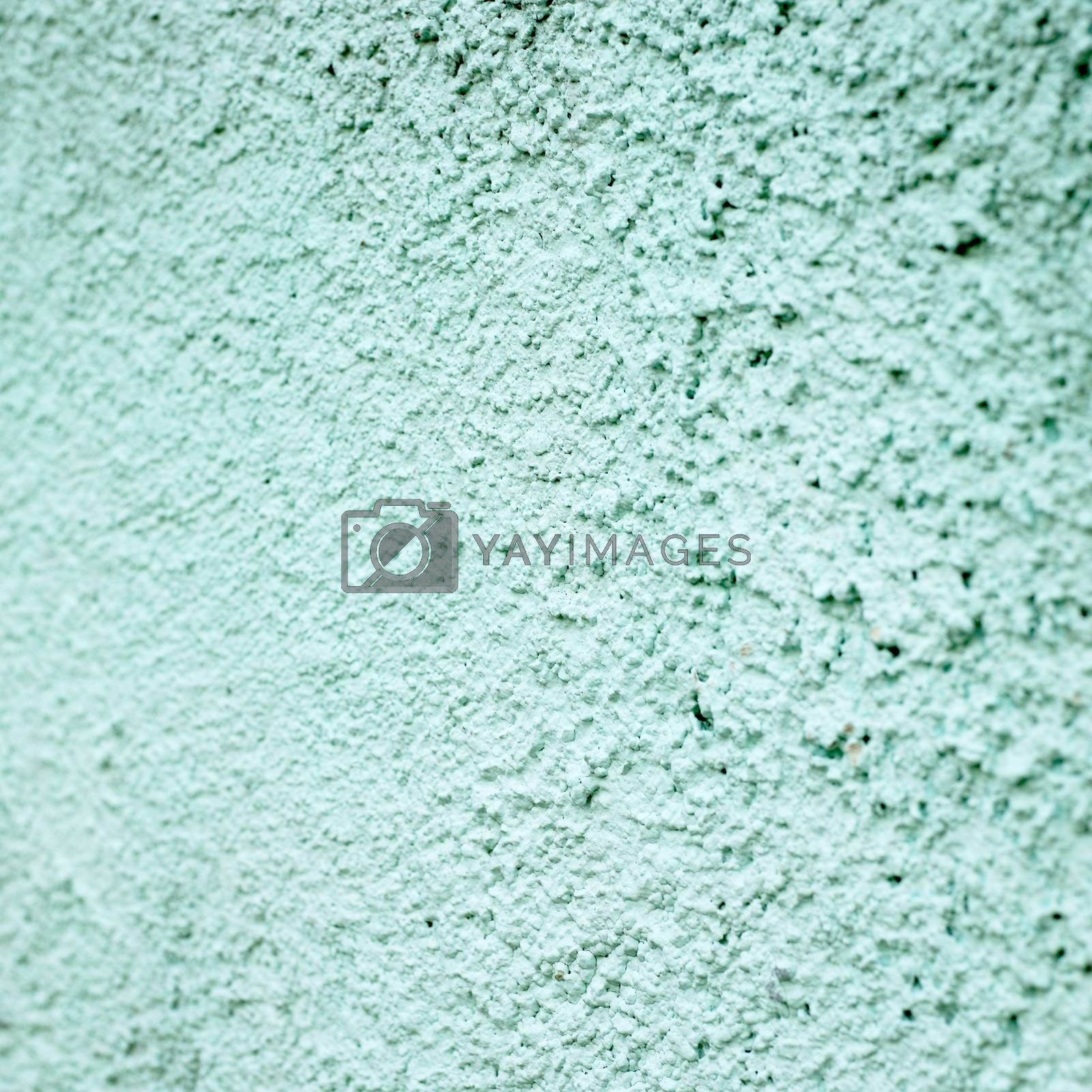 turquoise stucco wall close up
