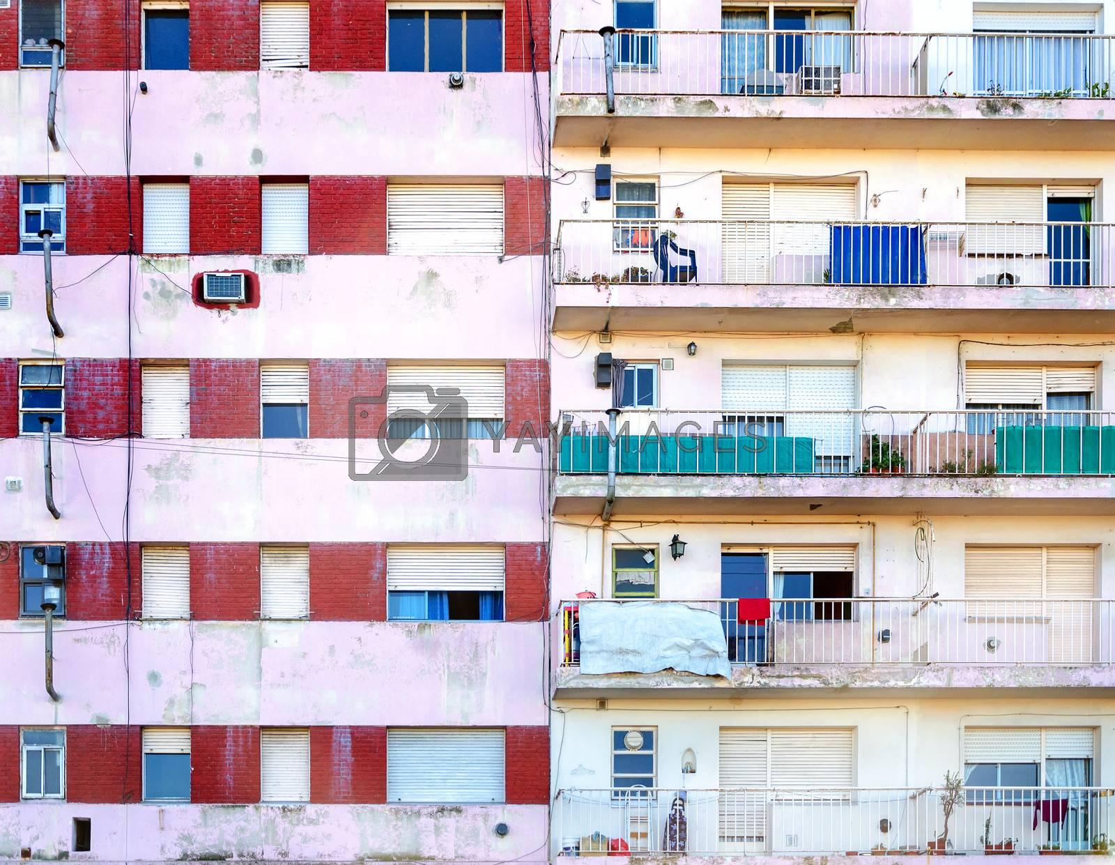 Facades of two poor apartment buildings in La Boca neighborhood of Buenos Aires