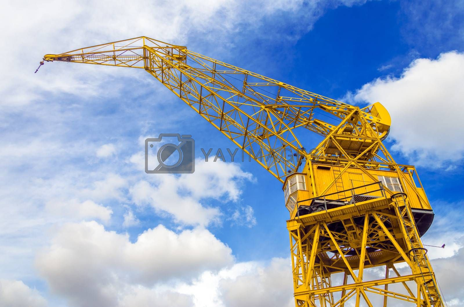 Old yellow crane and sky in Puerto Madero neighborhood of Buenos Aires, Argentina