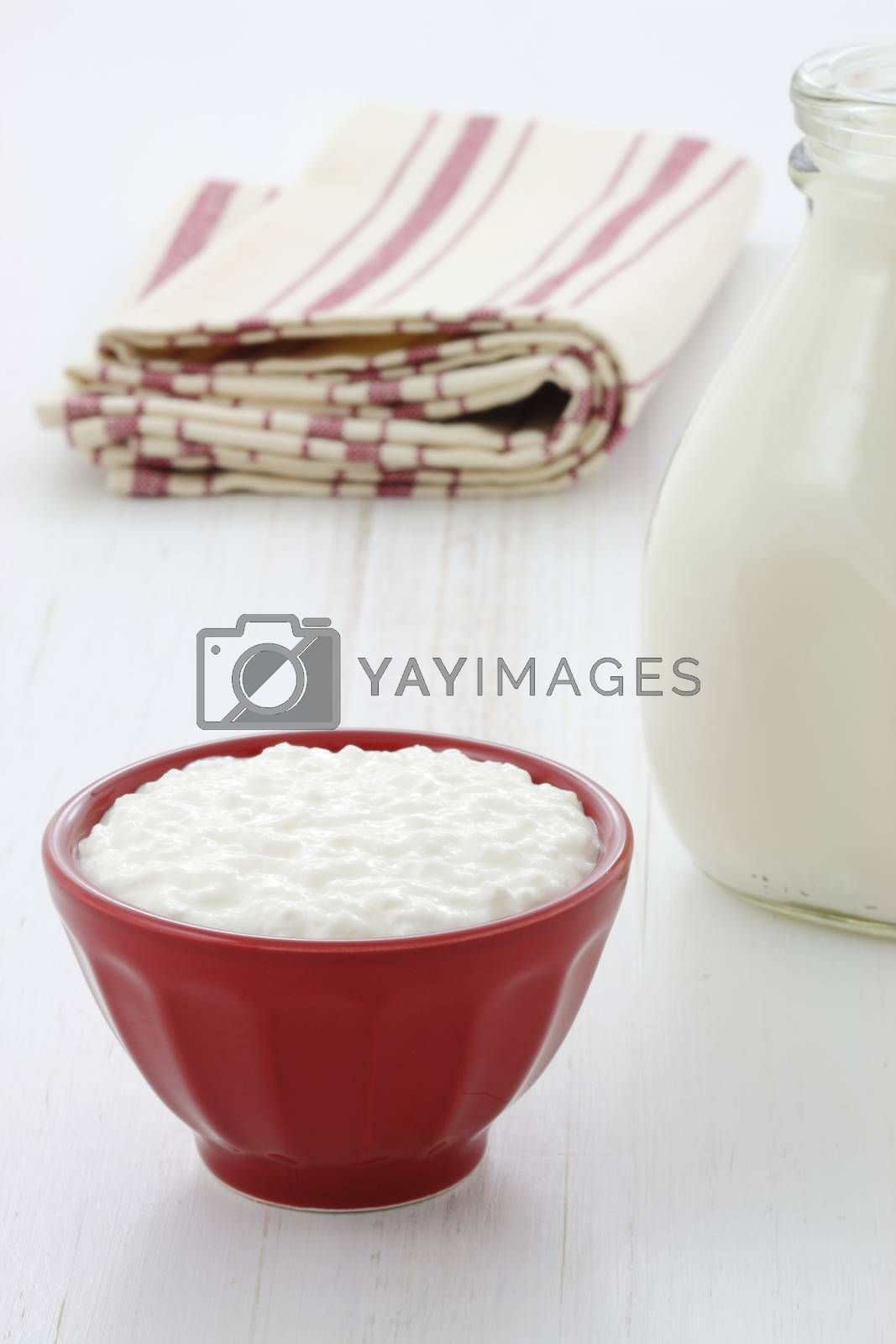 Cottage cheese and fresh milk on vintage french table linen.