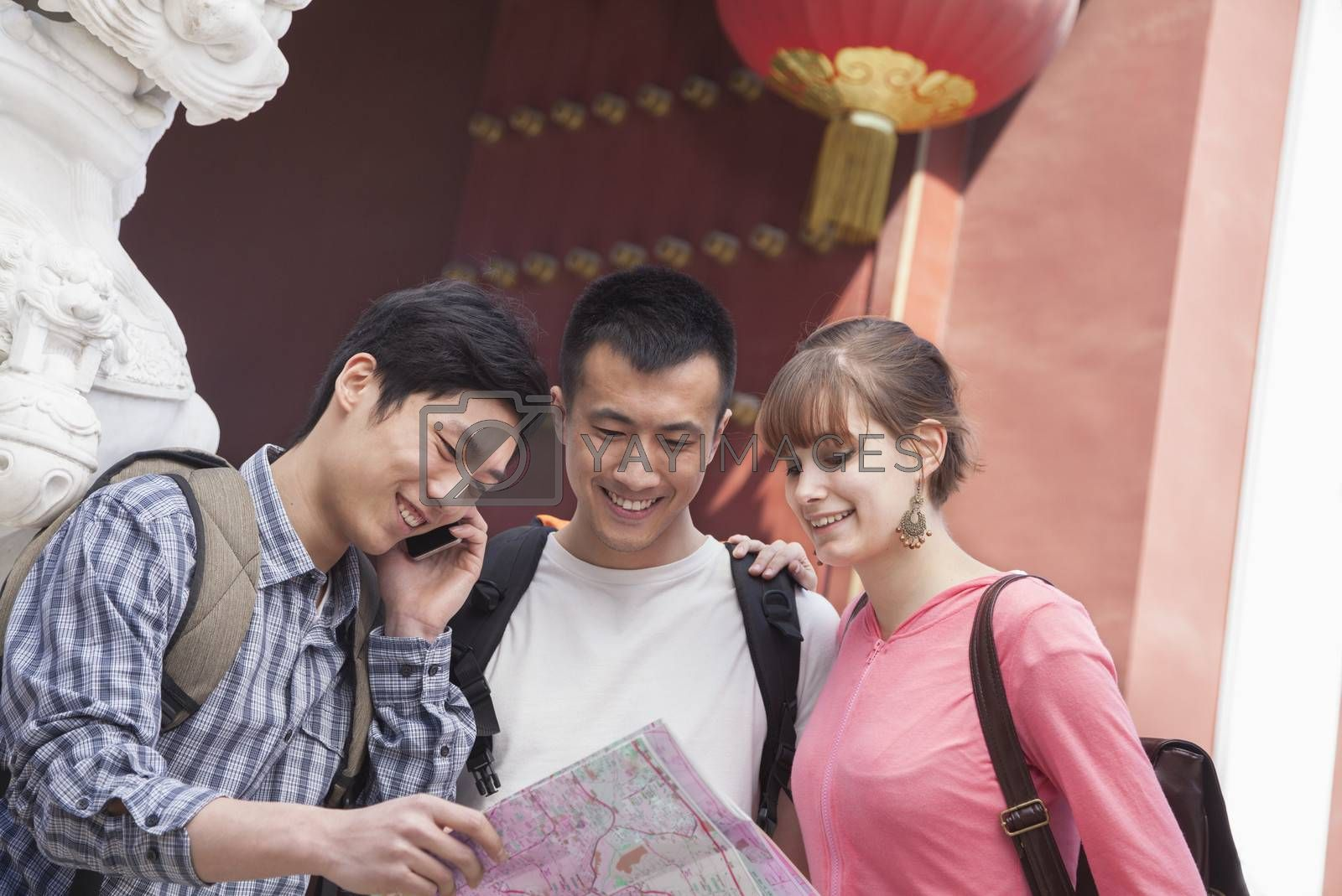 Three people looking at map.