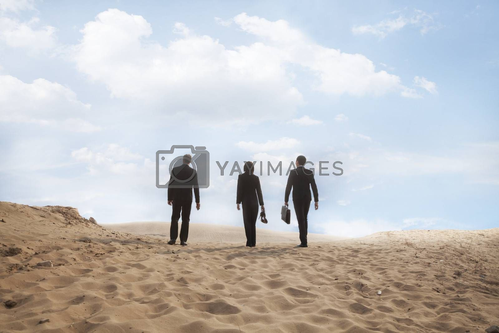 Three young business people walking through the desert, rear view, distant by XiXinXing