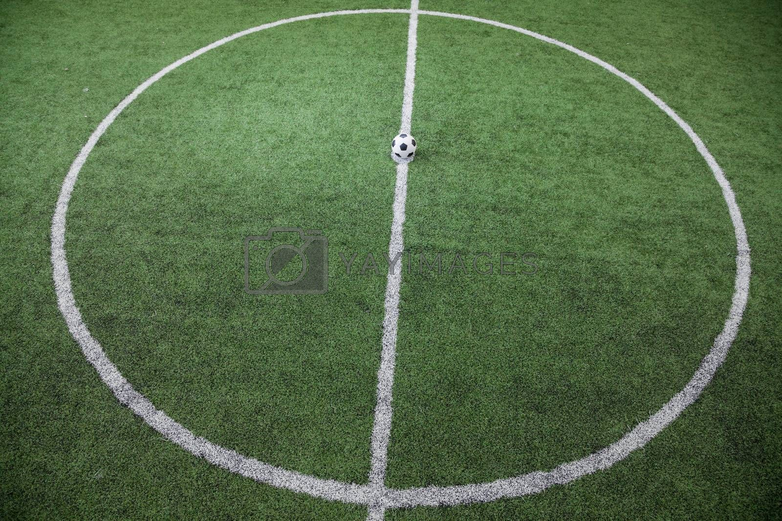 Soccer field with soccer ball on the line, high angle view by XiXinXing