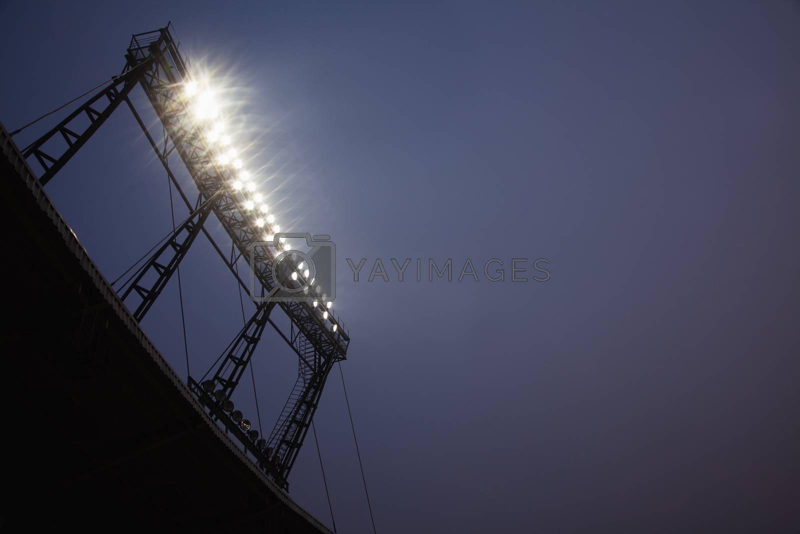 Stadium floodlights at night time, Beijing, China by XiXinXing