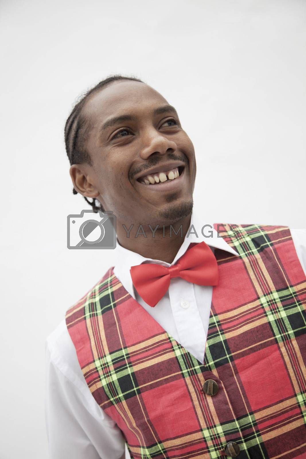 Portrait of young man in plaid vest and red bow tie, studio shot by XiXinXing