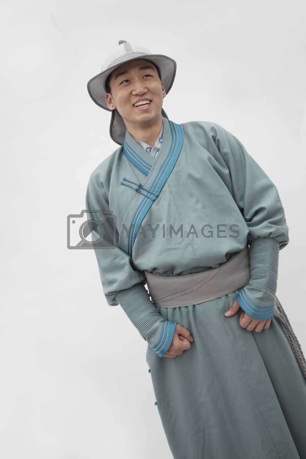Portrait of smiling young man in traditional clothing, studio shot by XiXinXing