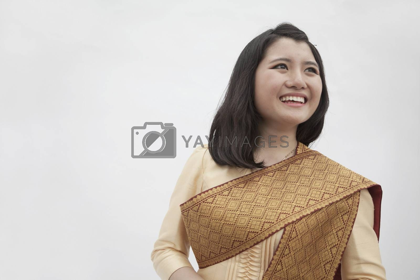 Portrait of smiling young woman in traditional clothing from Laos, studio shot by XiXinXing