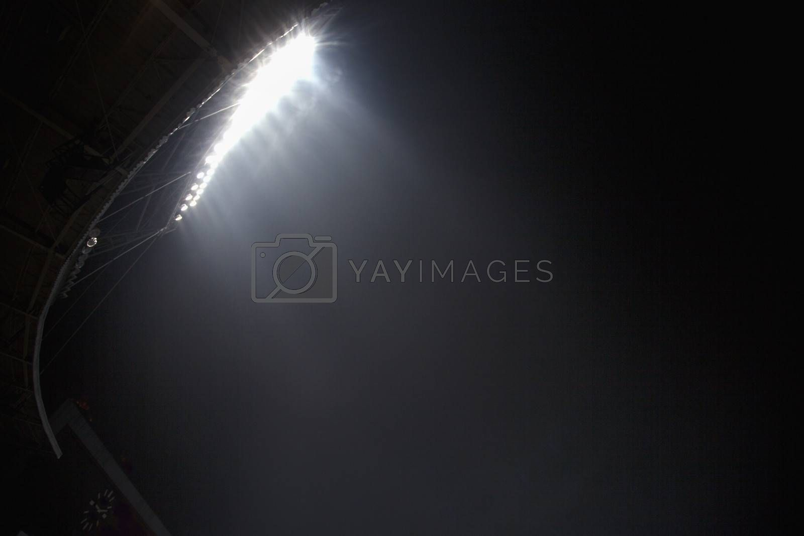 Stadium floodlights at night time, Beijing, China by XiXinXing