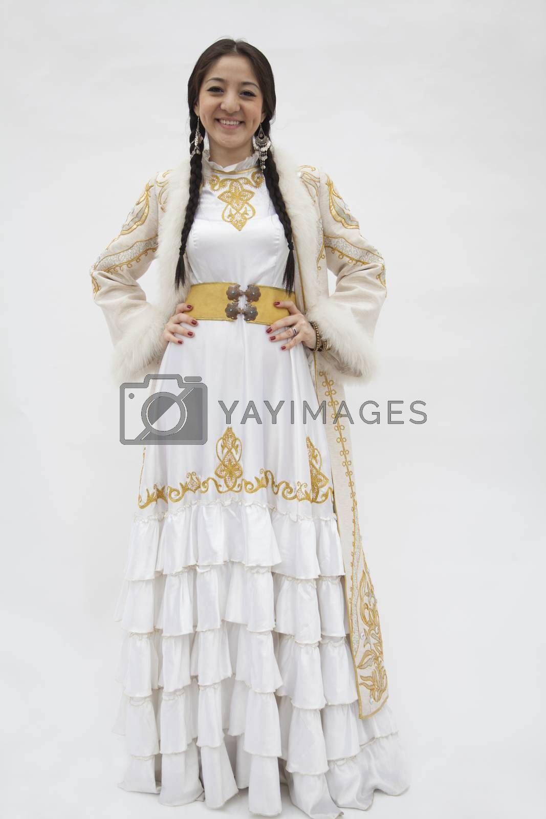 Portrait of young smiling woman with braids in traditional clothing from Kazakhstan, studio shot by XiXinXing