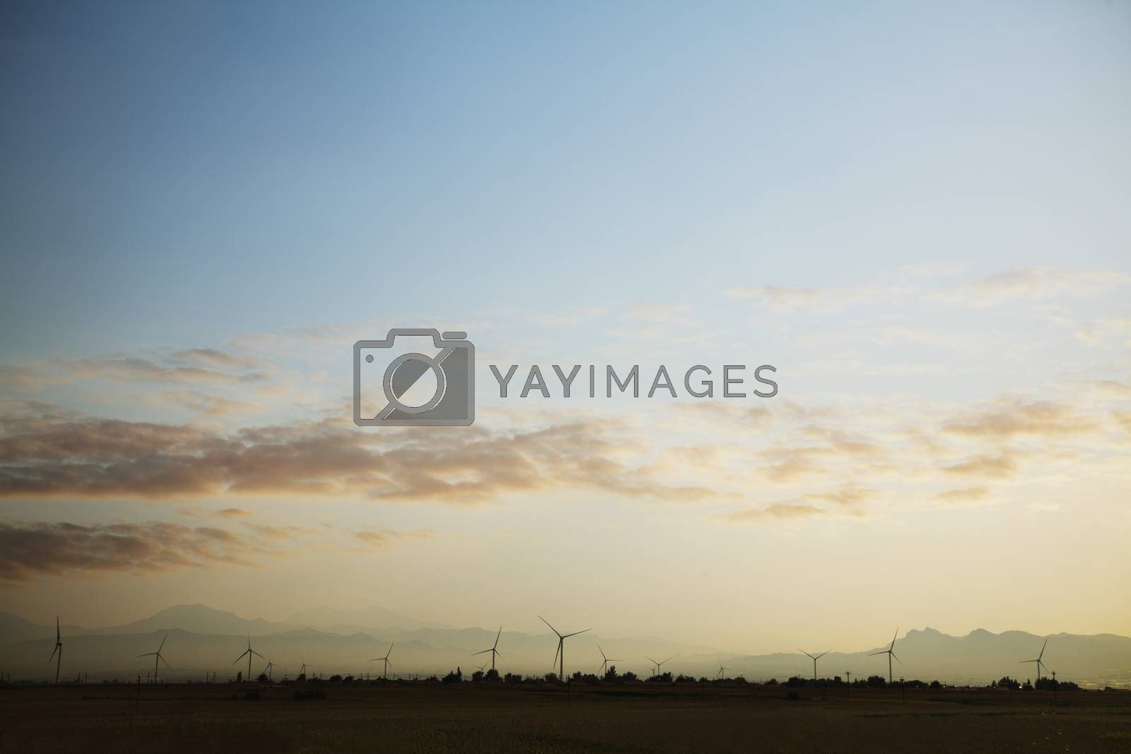 Landscape of a wind farm at sunset by XiXinXing