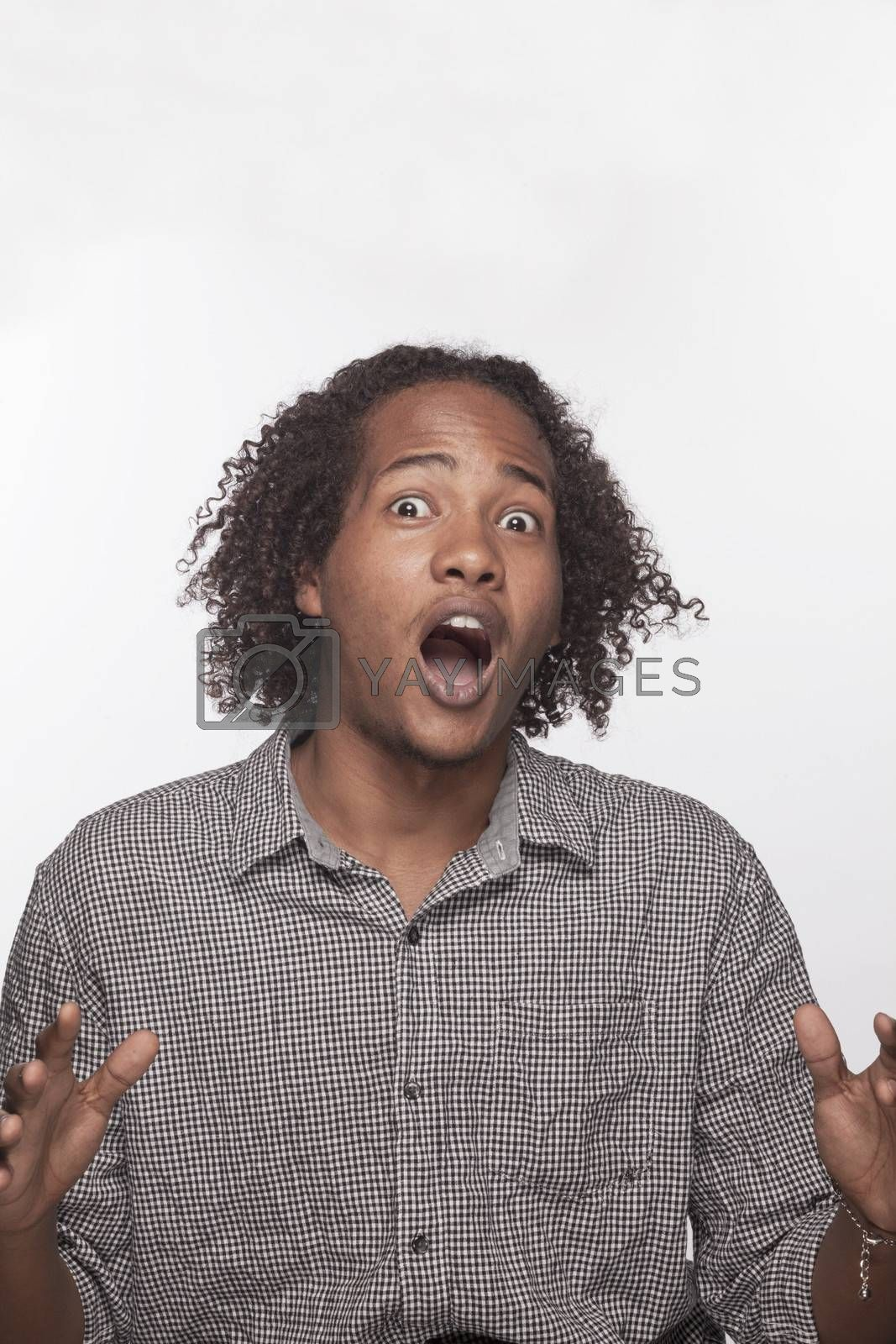 Portrait of shocked and surprised young man