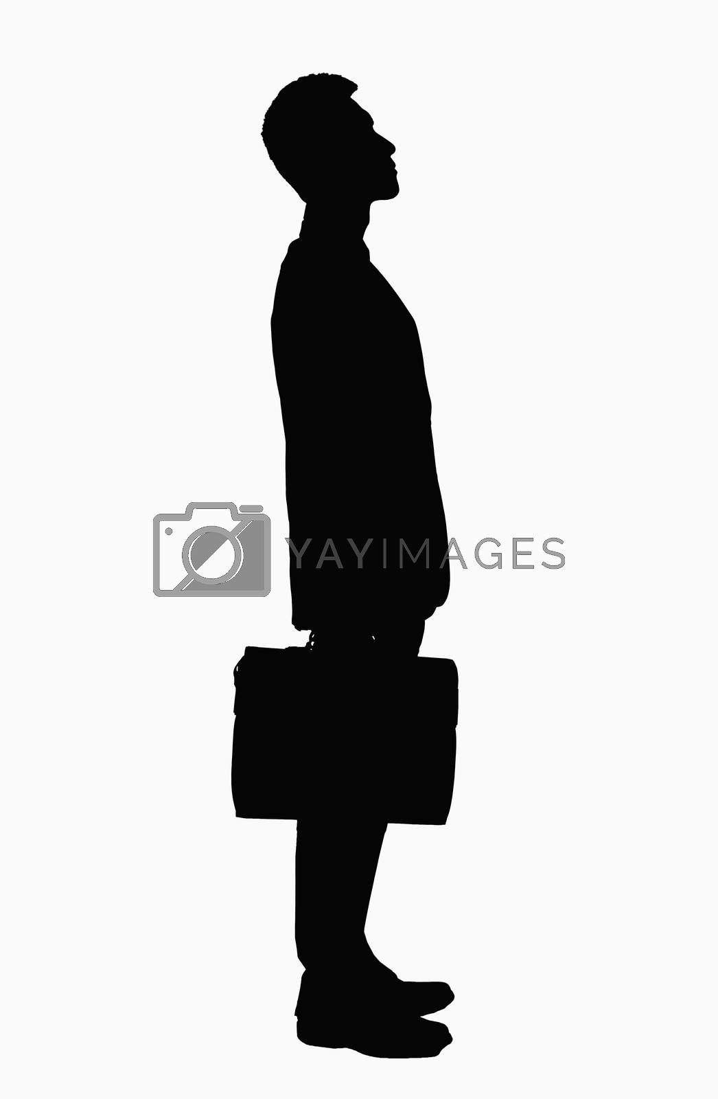 Silhouette of businessman with briefcase.