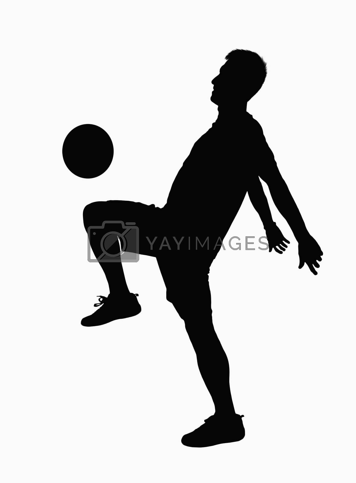 Silhouette of soccer player practicing juggling the ball.