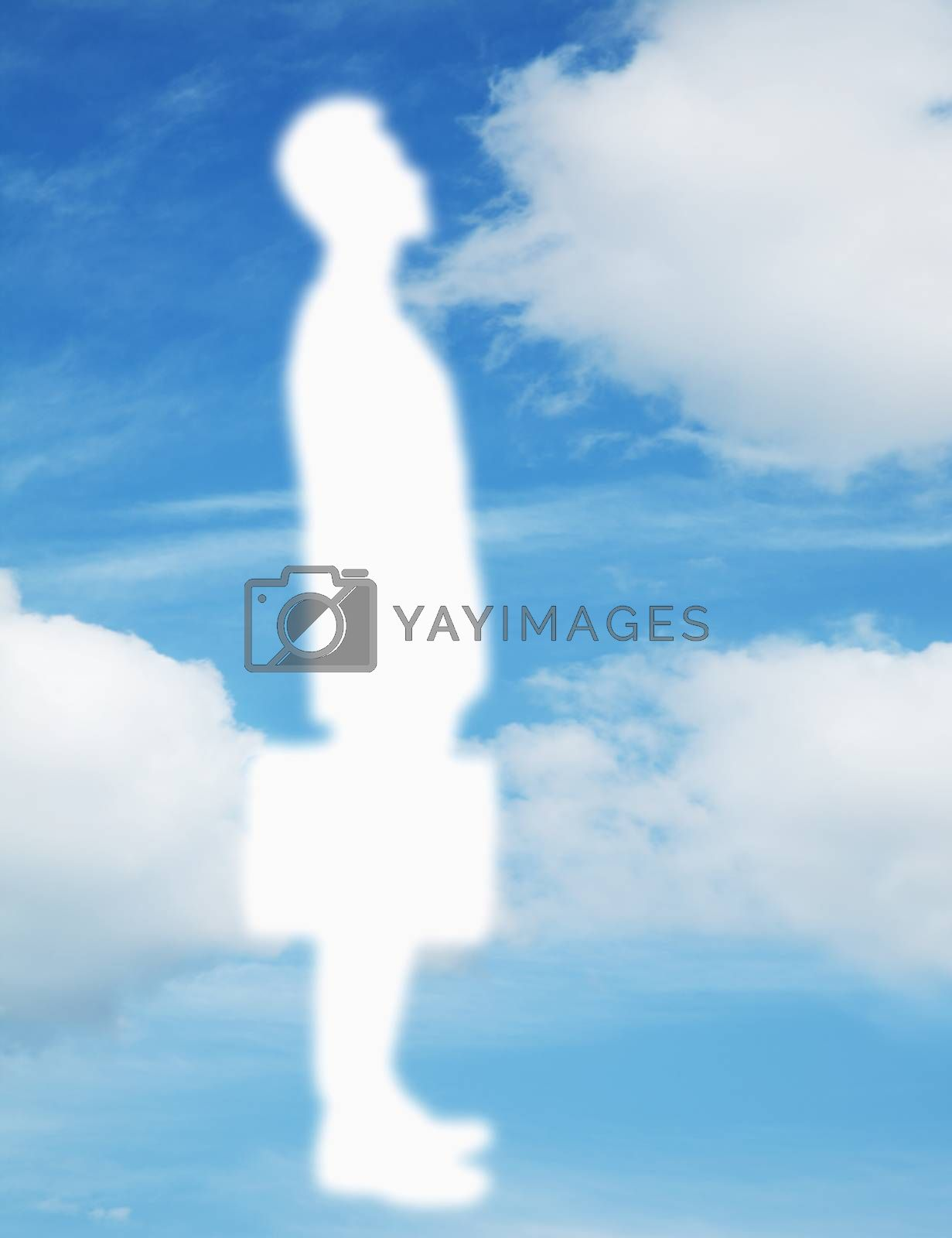 Silhouette of businessman holding a briefcase with a blue sky and clouds behind him