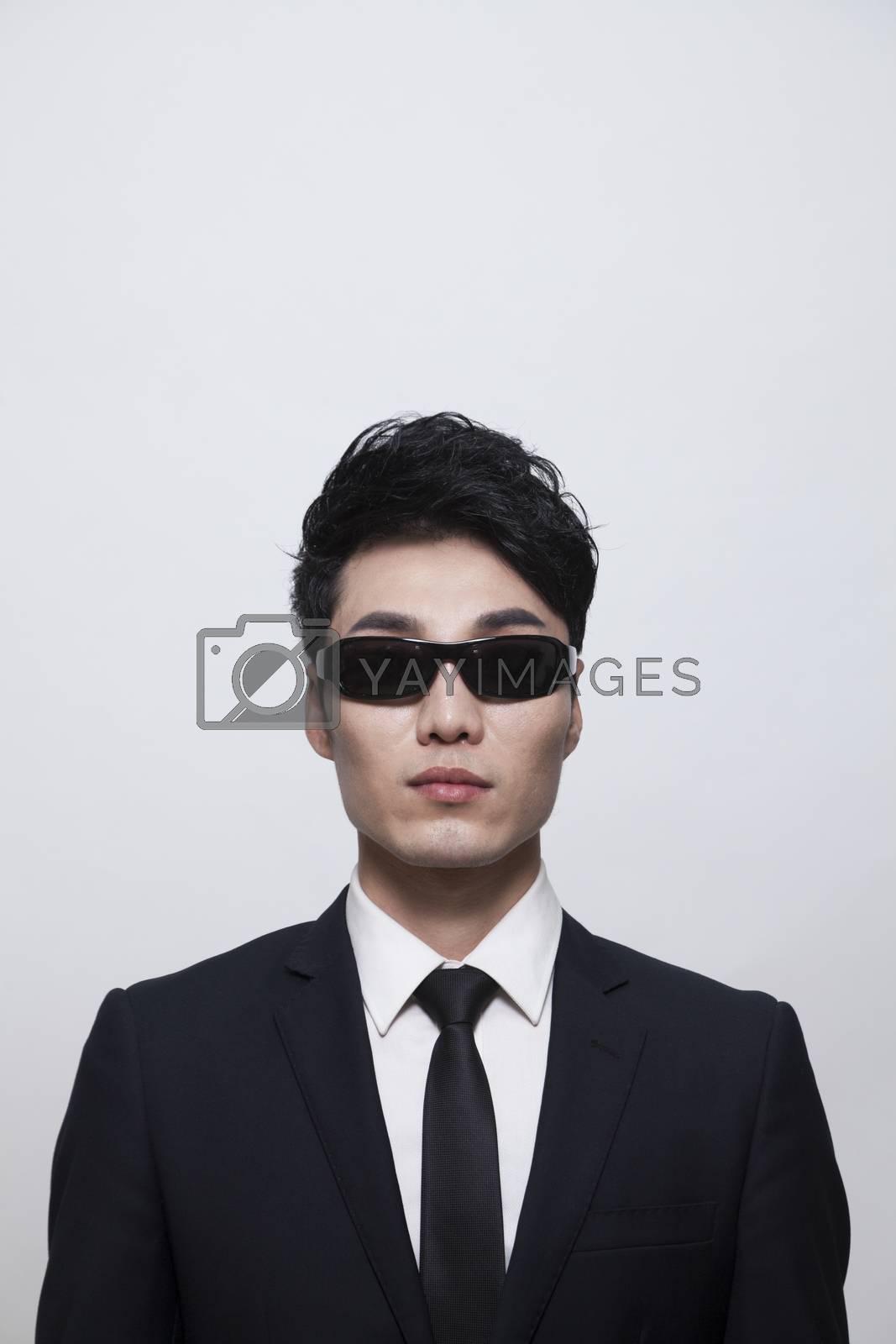 Cool businessman with sunglasses, studio shot
