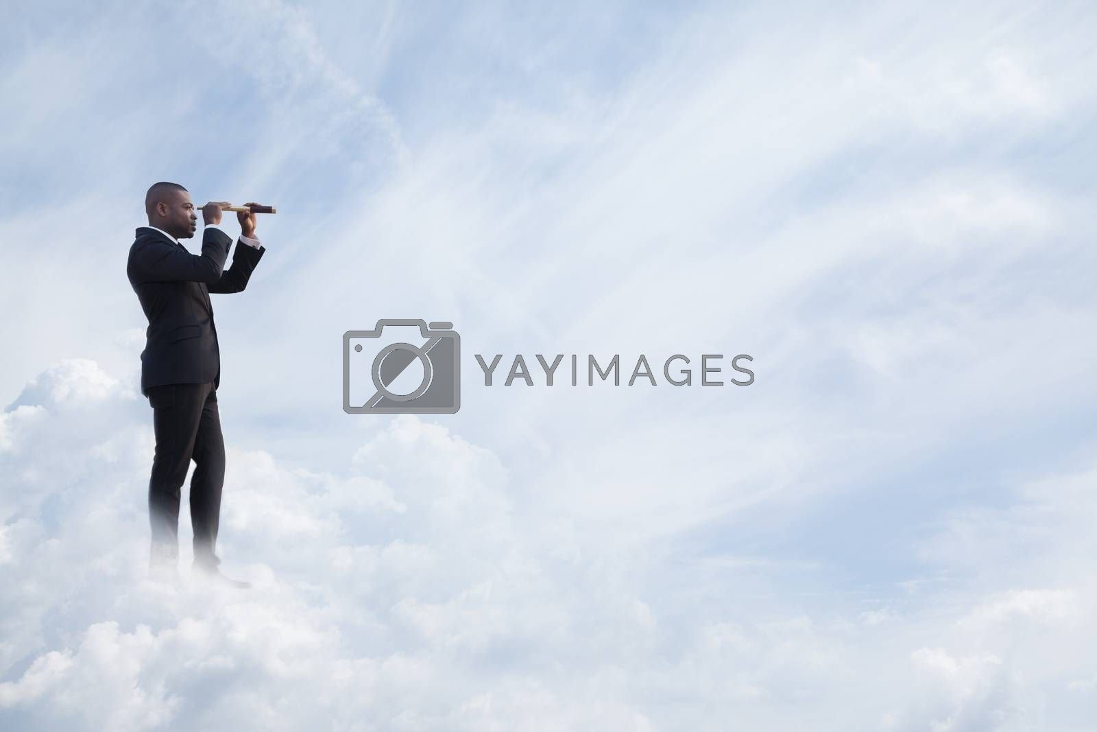 Young businessman looking through telescope in a dreamlike cloud world
